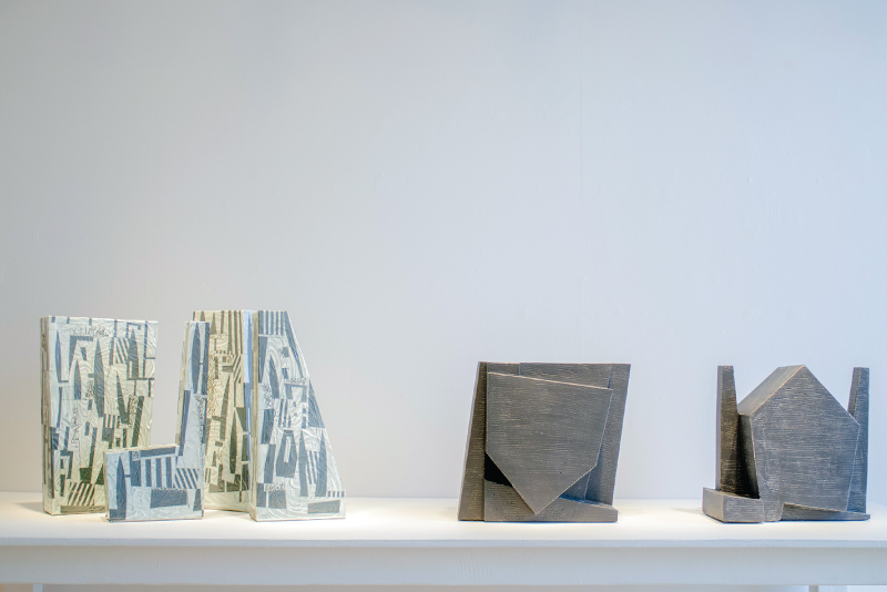 """Monuments"" stoneware, $2200-$2500, ""Black House with 2 Chimneys"" and ""Inverted Black House"" stoneware, $3500 by Strassberg"
